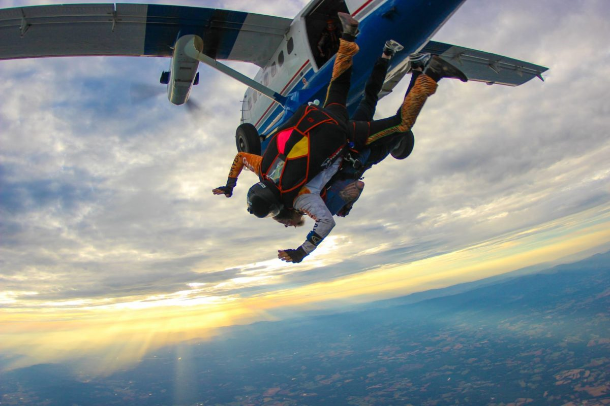 Exiting an airplane for a tandem skydive at 14,000 feet