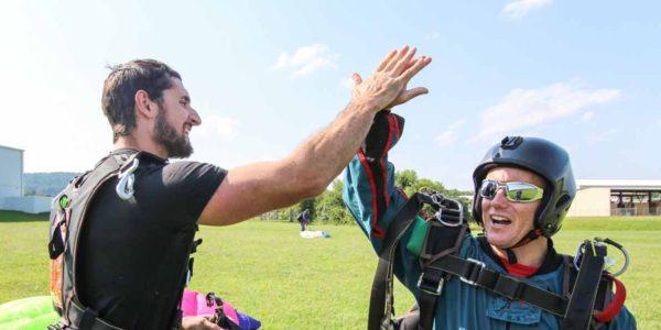 Skydive Orange Instructor and Tandem Student after Landing