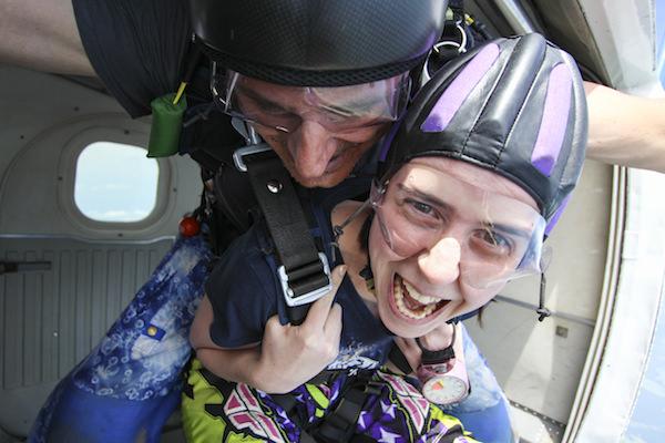 Happy Skydiver in Door of Plane