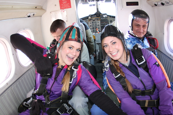 Two Tandem Skydiving Students in Airplane