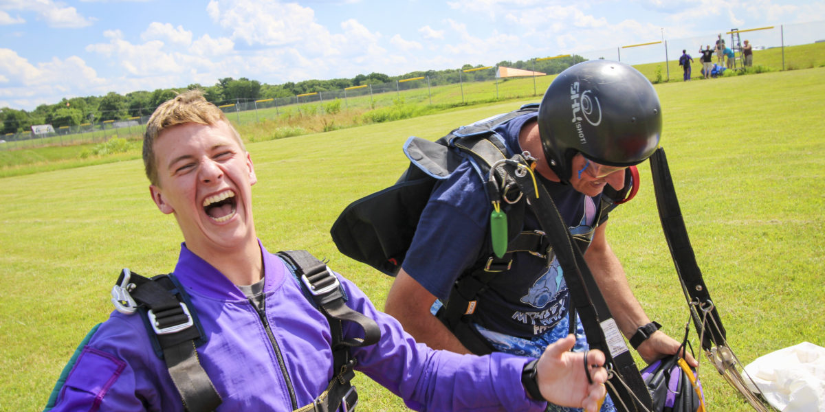 Pair of Skydivers Looking Extremely Happy after Jumping