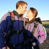 couple kissing before skydive