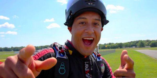 skydiver pointing at camera