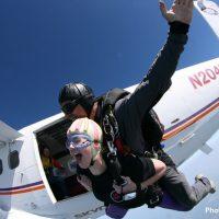 tandem student exiting plane at Skydive Orange