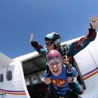 Tandem skydiving exit from plane