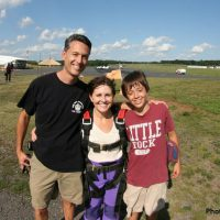 family photo with tandem skydive student