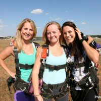 three friends in landing area at Skydive Orange