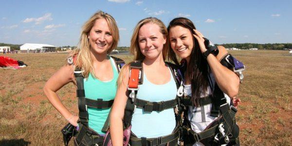 three friends in landing area at Skydive Orange
