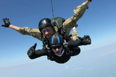 halo tandem student in freefall at skydive orange