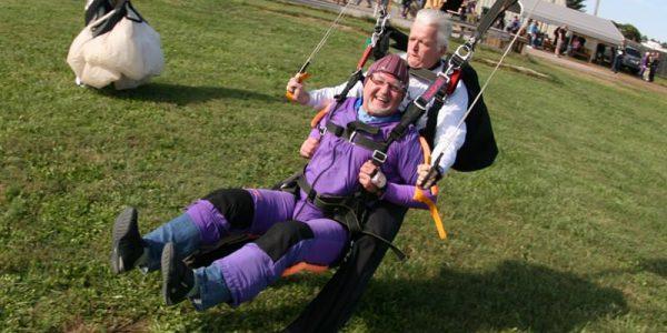 Happy tandem skydiving student landing at Skydive Orange