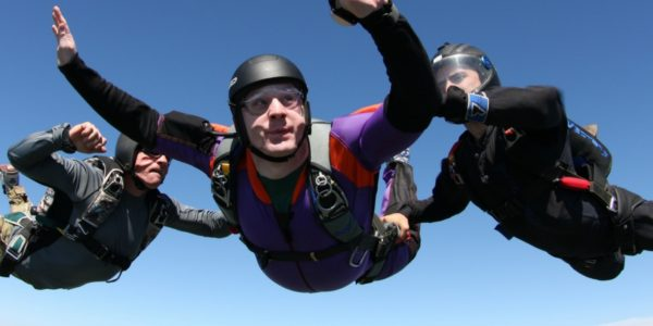 AFF student in freefall with 2 instructors