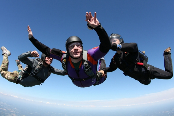 young man makes first jump towards skydiving certification