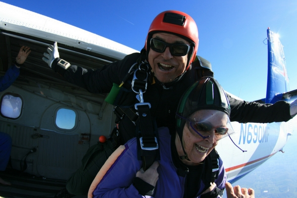 older woman exist skydiving plane