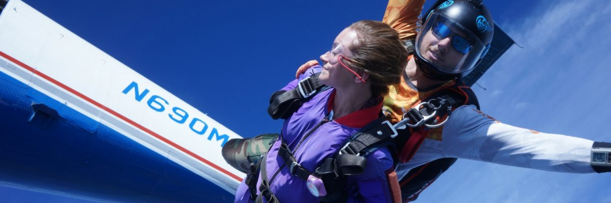young woman in skydiving freefall