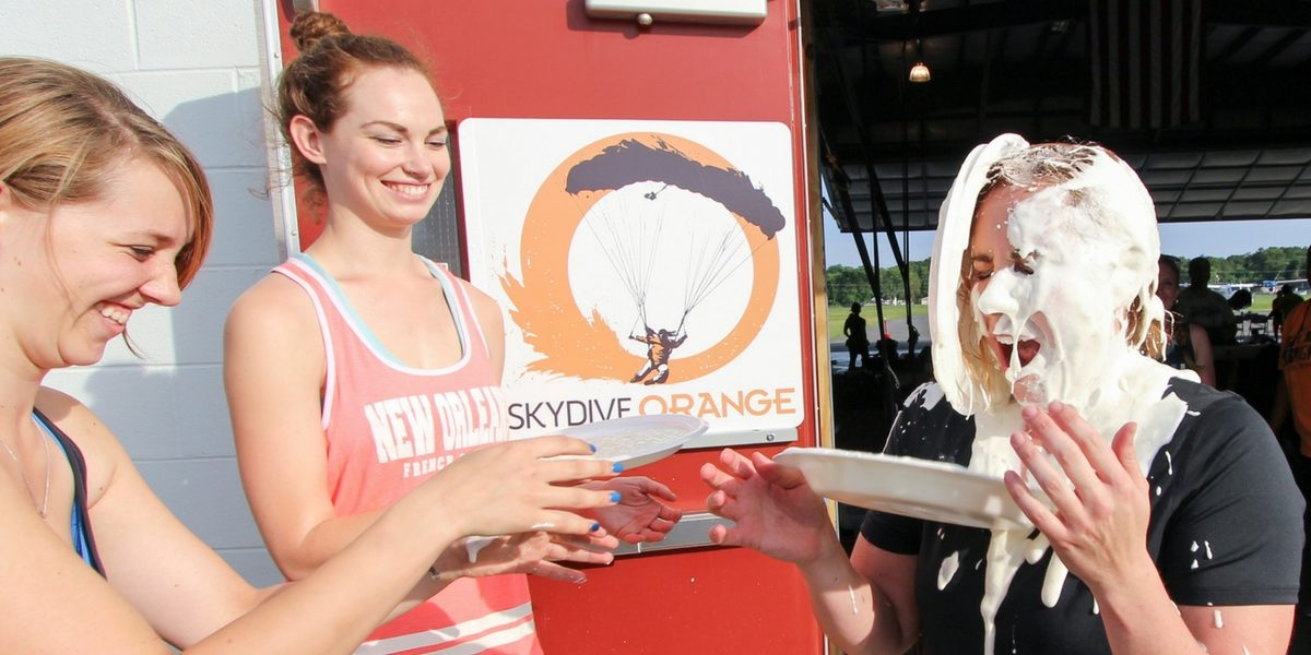 girls honor skydiving tradition of pie in the face