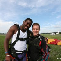 Skydive Orange student and instructor after successful landing