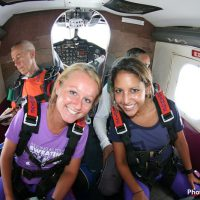 tandem skydiving students in jump plane