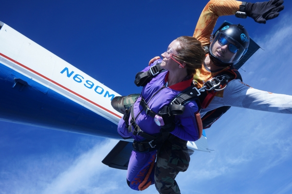 woman closes her eyes in skydiving freefall