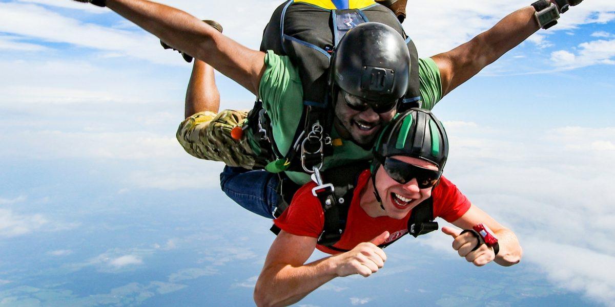 excited tandem student jumps at Skydive Orange