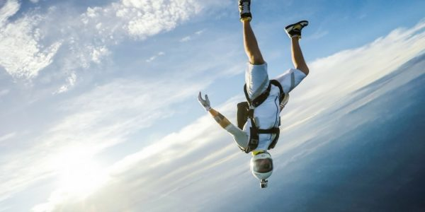fun jumper skydiving against clouds