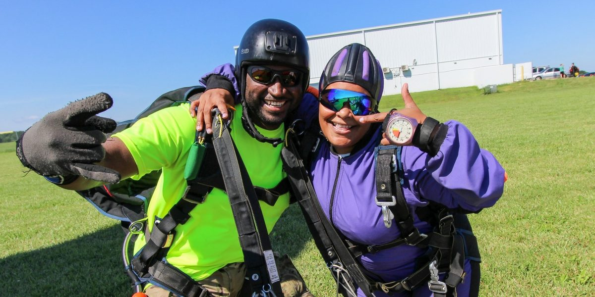 tandem skydiving beginner excited after landing