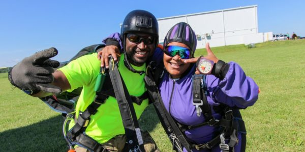 tandem skydiving beginner excited after landing