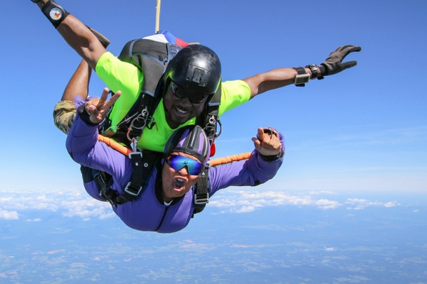 tandem skydiving student in freefall