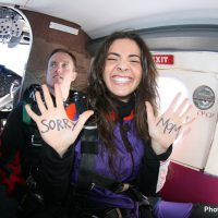 skydiving student with message on hands