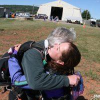 Tandem student hugging instructor after landing at Skydive Orange in Virginia