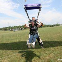Skydive Orange tandem skydiving student and instructor landing