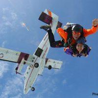 tandem skydiver and instructor after exit