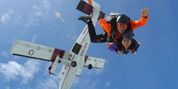tandem skydiver and instructor after exit