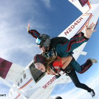 Skydive Orange tandem skydiving student exiting plane