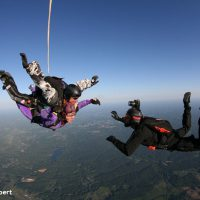 Videographer taking video of Skydive Orange tandem skydiving student