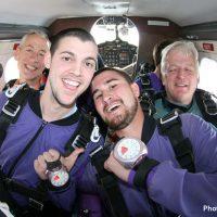 tandem skydiving students wearing altimeter
