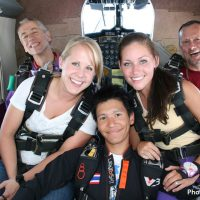 three friends in skydiving plane