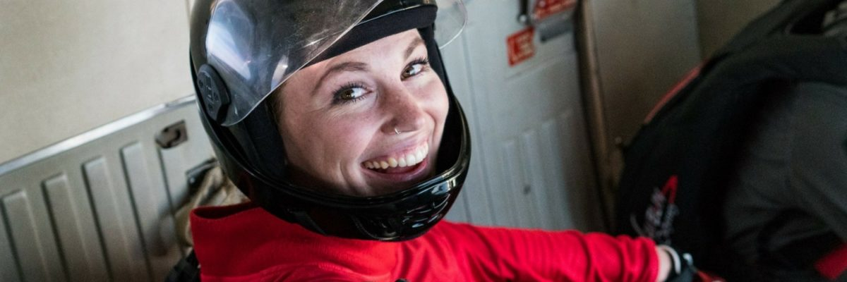 female skydiver gives a big smile