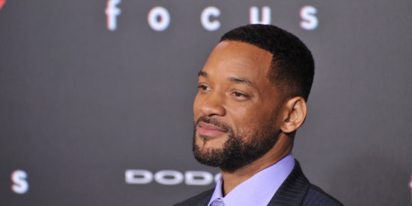 Will Smith smiling for the cameras.